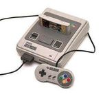 une photo de machine de jeu: Nintendo Super Nes